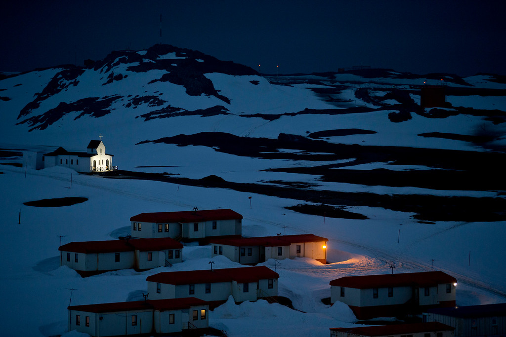 Description of . In this Jan. 20, 2015 photo, a church is lit in the town of Villa Las Estrellas on King George Island, Antarctica. Geologists are entranced by Antarctica's secrets. Clues to answering humanity's most basic questions are locked in this continental freezer the size of the United States and half of Canada: Where did we come from? Are we alone in the universe? What's the fate of our warming planet? (AP Photo/Natacha Pisarenko)