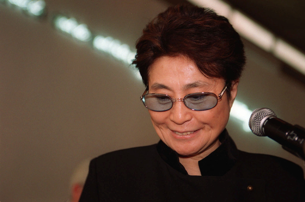 Description of . Yoko Ono, avant-garde artist and wife of late pop star John Lennon, finishes her statements during a press conference at the Israeli Museum in Jerusalem Friday Nov. 26 1999. Ono is in Israel for the opening of her exhibits in Jerusalem and in the northern town of Um al-Fahm (AP Photo/Ruth Fremson)