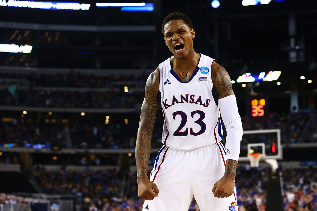 Description of . ARLINGTON, TX - MARCH 29:  Ben McLemore #23 of the Kansas Jayhawks reacts in the second half against the Kansas Jayhawks during the South Regional Semifinal round of the 2013 NCAA Men\'s Basketball Tournament at Dallas Cowboys Stadium on March 29, 2013 in Arlington, Texas.  (Photo by Ronald Martinez/Getty Images)