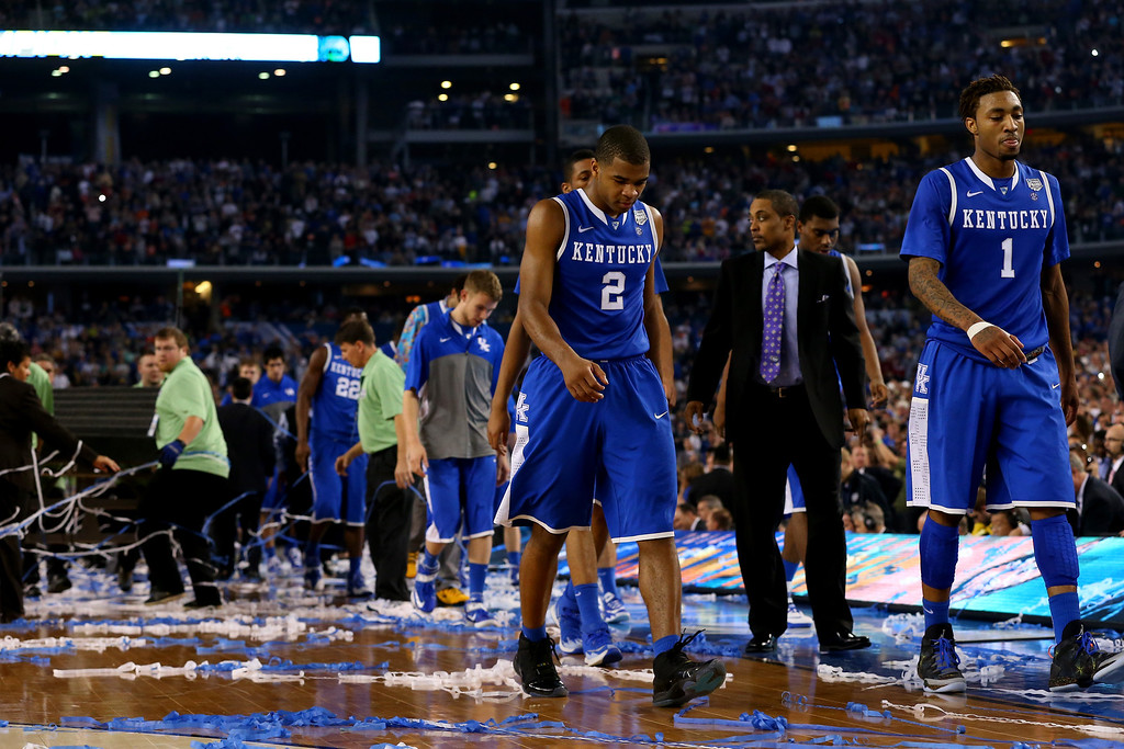 Description of . ARLINGTON, TX - APRIL 07: Aaron Harrison #2 and James Young #1 of the Kentucky Wildcats walk off the court after losing to the Connecticut Huskies 60-54 in the NCAA Men\'s Final Four Championship at AT&T Stadium on April 7, 2014 in Arlington, Texas.  (Photo by Ronald Martinez/Getty Images)