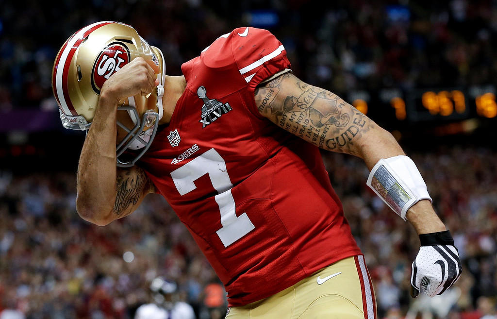 Description of . San Francisco 49ers quarterback Colin Kaepernick celebrates his touchdown against the Baltimore Ravens during the second half of the NFL Super Bowl XLVII football game, Sunday, Feb. 3, 2013, in New Orleans. (AP Photo/Dave Martin)