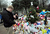 People pay their respects at a makeshift shrine to the victims of an elementary school shooting in Newtown, Connecticut, December 17, 2012.  Funerals began Monday in the little Connecticut town of Newtown after the school massacre that took the lives of 20 small children and six staff, triggering new momentum for a change to America's gun culture. The first burials, held under raw, wet skies, were for two six-year-old boys who were among those shot in Sandy Hook Elementary School. On Tuesday, the first of the girls, also aged six, was due to be laid to rest. There were no Monday classes at all across Newtown, and the blood-soaked elementary school was to remain a closed crime scene indefinitely, authorities said.AFP PHOTO/Emmanuel DUNAND/AFP/Getty Images