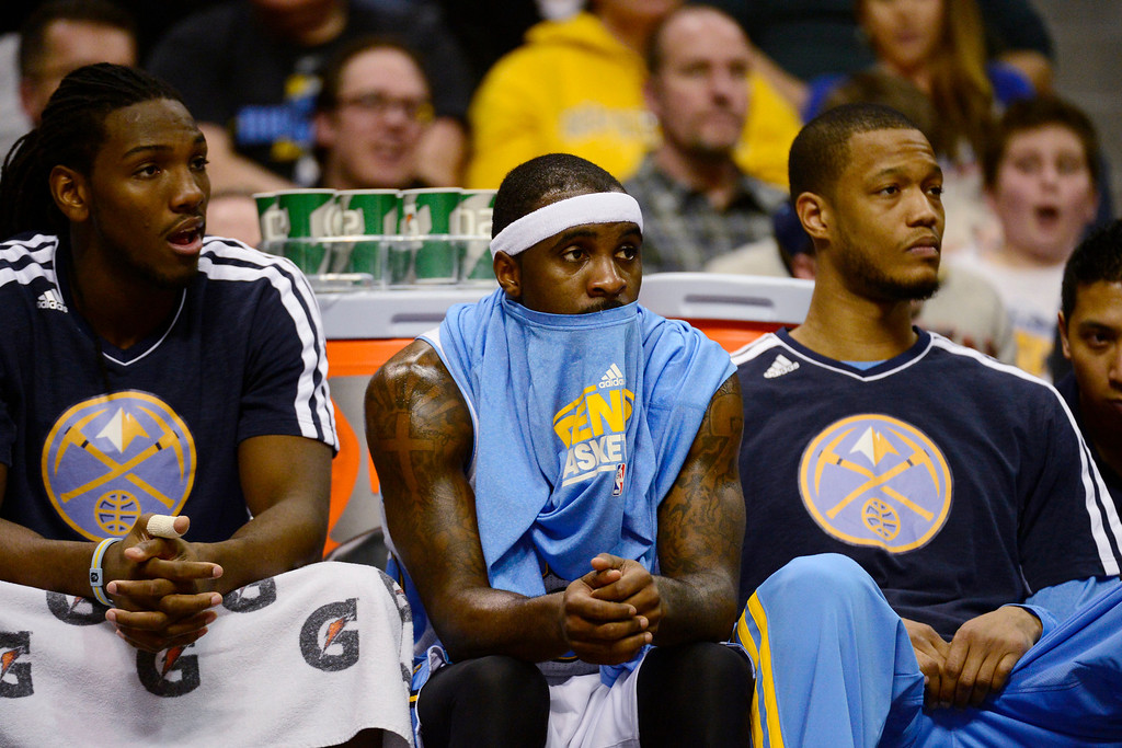 Description of . Denver Nuggets point guard Ty Lawson (3) sits on the bench against the Golden State Warriors during the second half of the Nuggets' 116-105 win at the Pepsi Center on Sunday, January 13, 2013. AAron Ontiveroz, The Denver Post