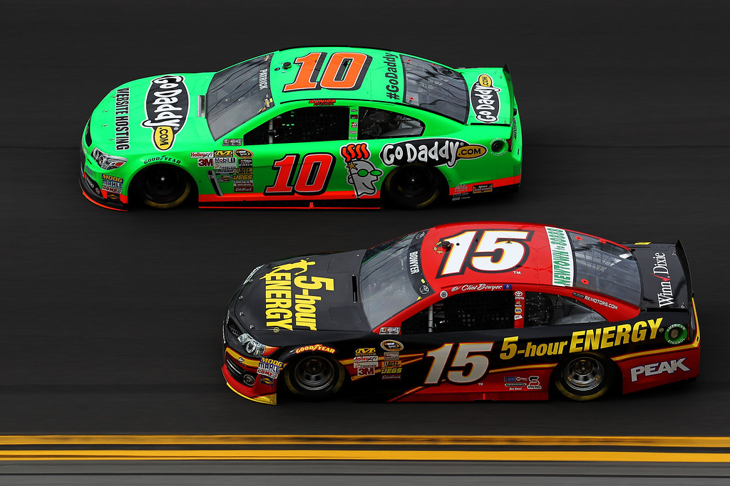 Description of . Clint Bowyer, driver of the #15 5-hour ENERGY Toyota, and Danica Patrick, driver of the #10 GoDaddy.com Chevrolet, race during the NASCAR Sprint Cup Series Daytona 500 at Daytona International Speedway on February 24, 2013 in Daytona Beach, Florida.  (Photo by Todd Warshaw/Getty Images)