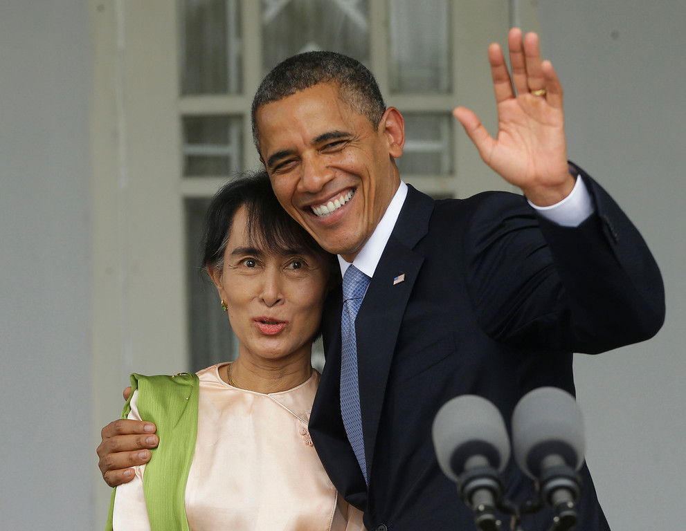 Description of . In this Nov. 19, 2012 file photo, U.S. President Barack Obama, right, waves as he embraces Myanmar democracy activist Aung San Suu Kyi after addressing members of the media at Suu Kyi's residence in Yangon, Myanmar. Obama became the first U.S. president to visit the Asian nation also known as Burma. (AP Photo/Pablo Martinez Monsivais, File)