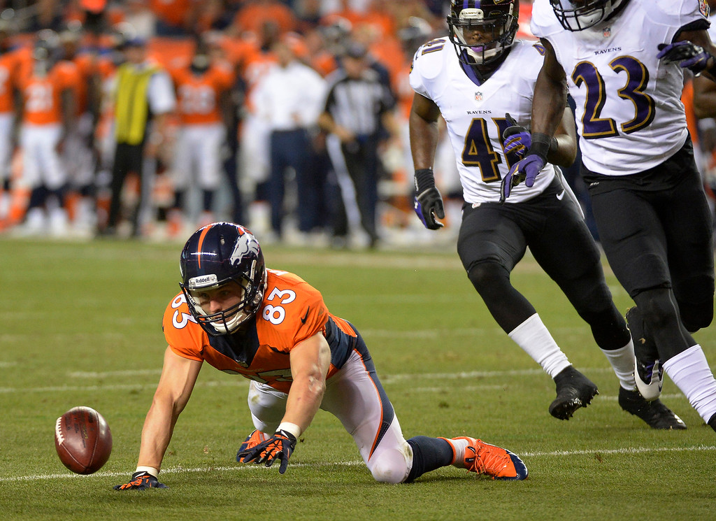 Description of . Denver Broncos wide receiver Wes Welker (83) fumbles the ball in the second quarter.   (Photo by John Leyba/The Denver Post)