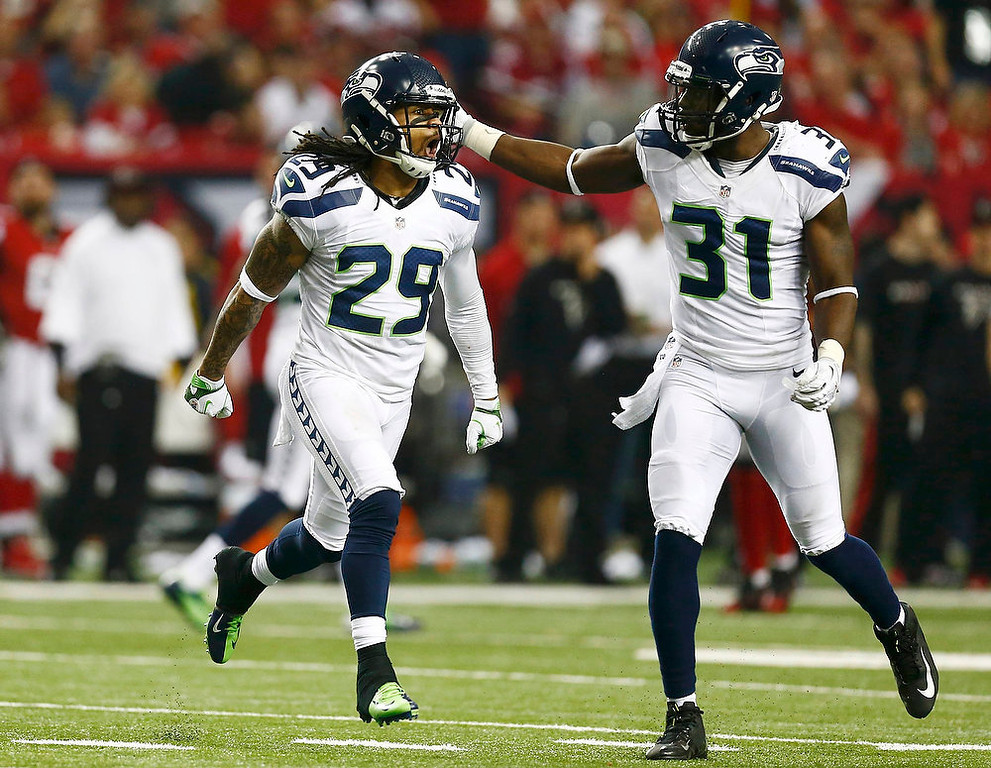 Description of . Seattle Seahawks free safety Earl Thomas (L) celebrates his interception on the Atlanta Falcons with teammate Kam Chancellor during the fourth quarter in their NFL NFC Divisional playoff football game in Atlanta, Georgia January 13, 2013. REUTERS/Chris Keane