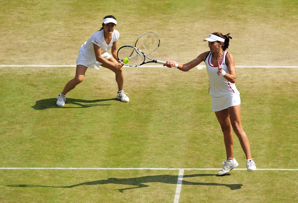 Description of . Japan\'s Shuko Aoyama (L) and South Africa\'s Chanelle Scheepers play against China\'s Peng Shuai and Taiwan\'s Hsieh Su-Wei during their ladies doubles semi-final match on day eleven of the 2013 Wimbledon Championships tennis tournament at the All England Club in Wimbledon, southwest London, on July 5, 2013. GLYN KIRK/AFP/Getty Images
