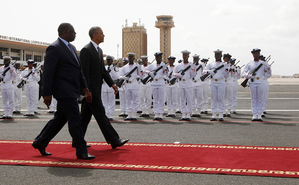 Description of . U.S. President Barack Obama  walks with Senegal's President Macky Sall to Air Force One, as Obama departs Dakar, June 28, 2013. Obama heads to South Africa on Friday hoping to see ailing icon Nelson Mandela, after wrapping up a visit to Senegal that focused on improving food security and promoting democratic institutions.  REUTERS/Jason Reed