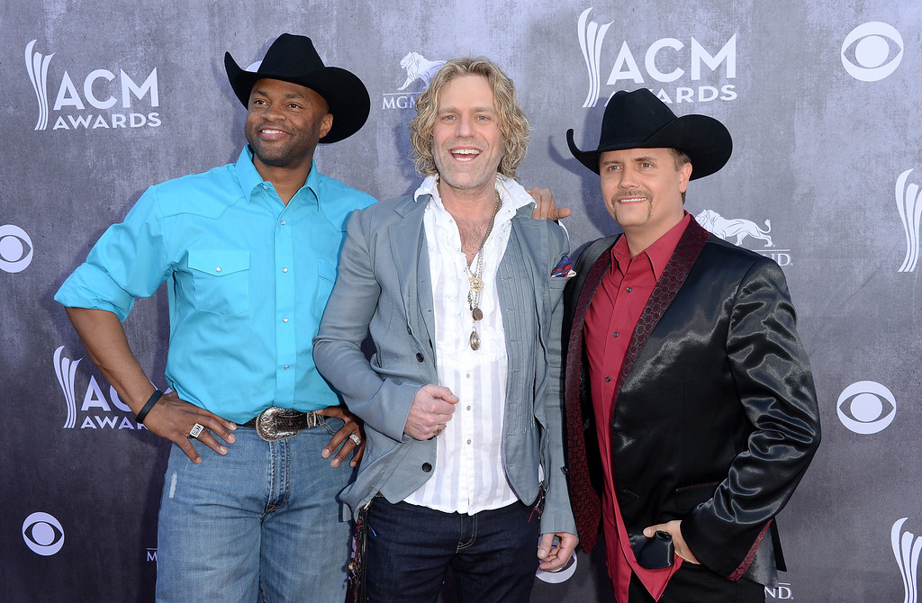 Description of . LAS VEGAS, NV - APRIL 06:  (L-R) Musicians Cowboy Troy, Big Kenny and John Rich (Big & Rich) attend the 49th Annual Academy Of Country Music Awards at the MGM Grand Garden Arena on April 6, 2014 in Las Vegas, Nevada.  (Photo by Jason Merritt/Getty Images)