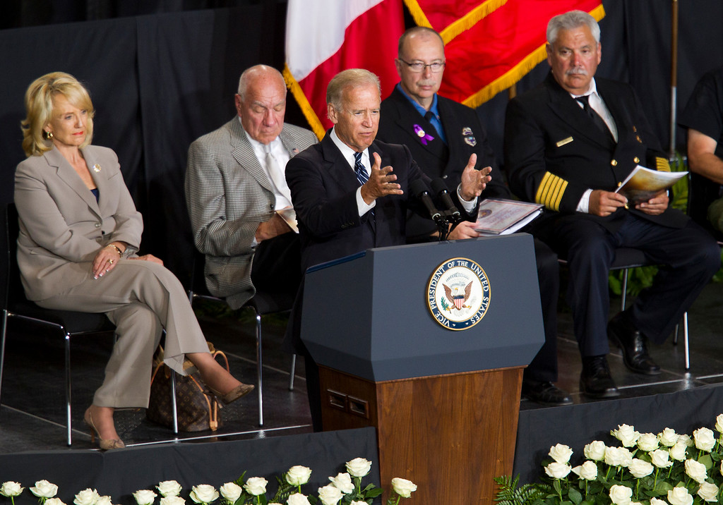 Description of . Vice President Joe Biden speaks during a memorial service for the 19 fallen firefighters at Tim's Toyota Center in Prescott Valley, Ariz. on Tuesday, July 9, 2013.    (AP Photo/The Arizona Republic, Michael Chow, Pool)