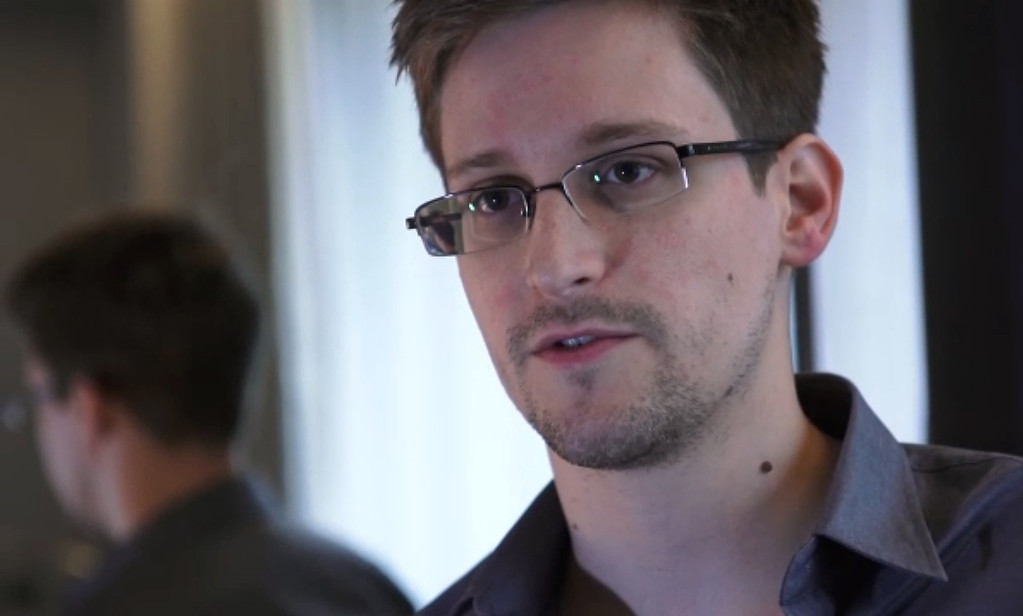Description of . Edward Snowden, who had been working at the National Security Agency for the past four years, speaking during an interview with The Guardian newspaper at an undisclosed location in Hong Kong. The 29-year-old government contractor revealed himself as the source behind bombshell leaks of US monitoring of Internet users and phone records, as US intelligence pressed for a criminal probe.  