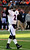 Baltimore Ravens quarterback Tyrod Taylor (2) walks off the field after the Ravens scored against the Cincinnati Bengals in the first half of an NFL football game on Sunday, Dec. 30, 2012, in Cincinnati. (AP Photo/Tom Uhlman)