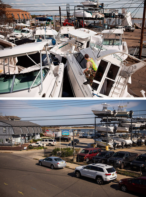 Description of . HIGHLANDS, NJ - NOVEMBER 1:  (top) A volunteer surveys a pile of boats, which were moved by Superstorm Sandy, on November 1, 2012 in Highlands, New Jersey.   HIGHLANDS, NJ - OCTOBER 22:  (bottom)  Boats are stored at a marina in Highlands, New Jersey October 22, 2013.  Hurricane Sandy made landfall on October 29, 2012 near Brigantine, New Jersey and affected 24 states from Florida to Maine and cost the country an estimated $65 billion.   (Photos by Andrew Burton/Getty Images)