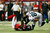 Stephen Nicholas #54 of the Atlanta Falcons tackles  Zach Miller #86 of the Seattle Seahawks in the second quarter of the NFC Divisional Playoff Game at Georgia Dome on January 13, 2013 in Atlanta, Georgia.  (Photo by Kevin C. Cox/Getty Images)