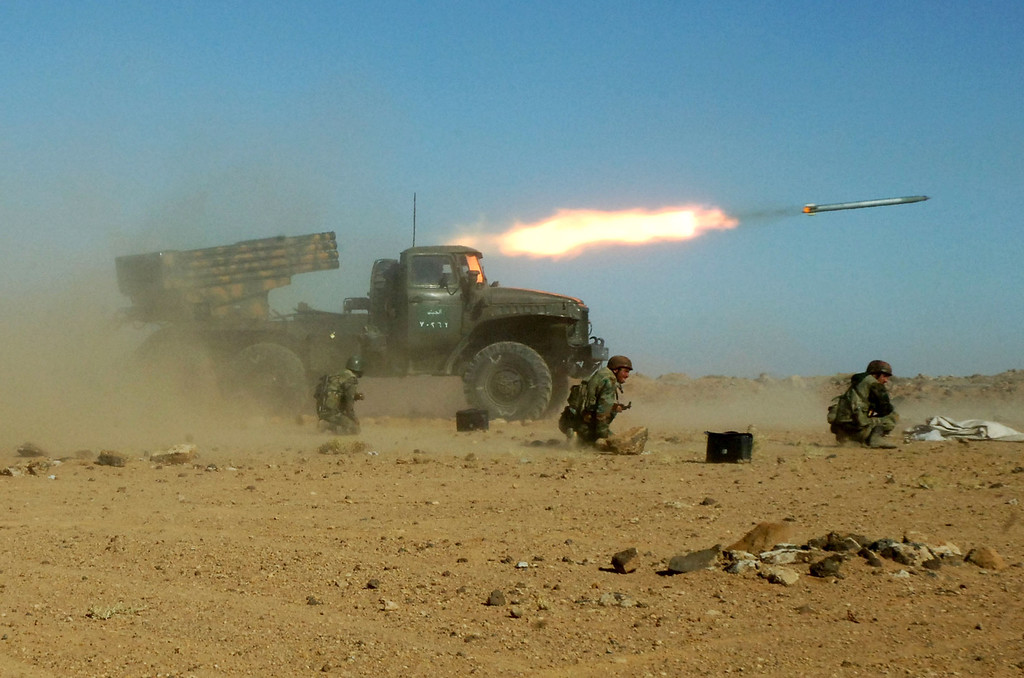 Description of . In this undated photo provided late Sunday Dec. 4, 2011 by the Syrian official news agency SANA, which they claim shows Syrian soldiers kneeling next to a multiple rocket launcher as they fire missiles during a maneuver at an unknown location, in Syria. Syrian President Bashar Assad's regime has a host of options if the United States launches military strikes against it. It could directly retaliate with rockets or unleash allies like Hezbollah against Western targets. Or it could do nothing -- and score propaganda points as a victim of