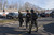 Connecticut State Police walk near the scene of an elementary school shooting on December 14, 2012 in Newtown, Connecticut. According to reports, there are more than 20 dead, most children, after a gunman opened fire in at the Sandy Hook Elementary School. The shooter was also killed.  (Photo by Douglas Healey/Getty Images)
