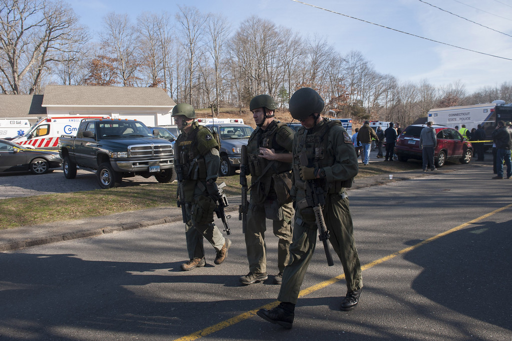 . Connecticut State Police walk near the scene of an elementary school shooting on December 14, 2012 in Newtown, Connecticut. According to reports, there are more than 20 dead, most children, after a gunman opened fire in at the Sandy Hook Elementary School. The shooter was also killed.  (Photo by Douglas Healey/Getty Images)