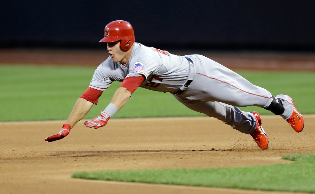 Description of . American League's Mike Trout, of the Los Angeles Angels, dives safely to second base for a double during the first inning of the MLB All-Star baseball game, on Tuesday, July 16, 2013, in New York. (AP Photo/Kathy Willens)