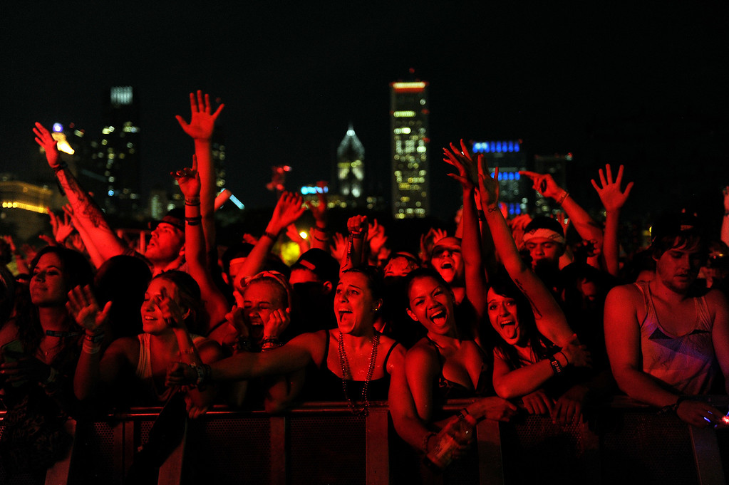 Description of . Fans cheer as Knife Party performs during Lollapalooza at Grant Park on August 4, 2013 in Chicago, Illinois. (Photo by Seth McConnell/The Denver Post)