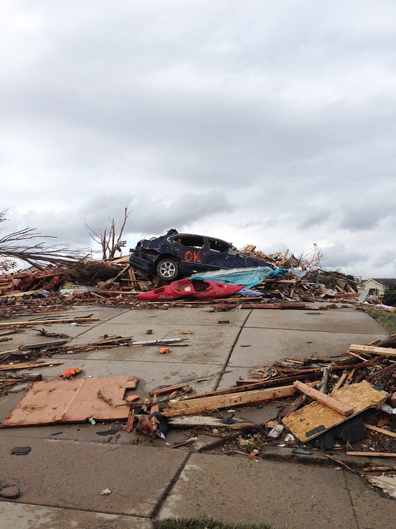 Description of . A view of part of Washington, Ill. is seen Sunday, Nov. 17, 2013 after a tornado moved through the area. Intense thunderstorms and tornadoes swept across the Midwest on Sunday, causing extensive damage in several central Illinois communities while sending people to their basements for shelter and even prompting officials at Soldier Field in Chicago to evacuate the stands and delay the Bears game.  (AP Photo/Alex Kareotes)