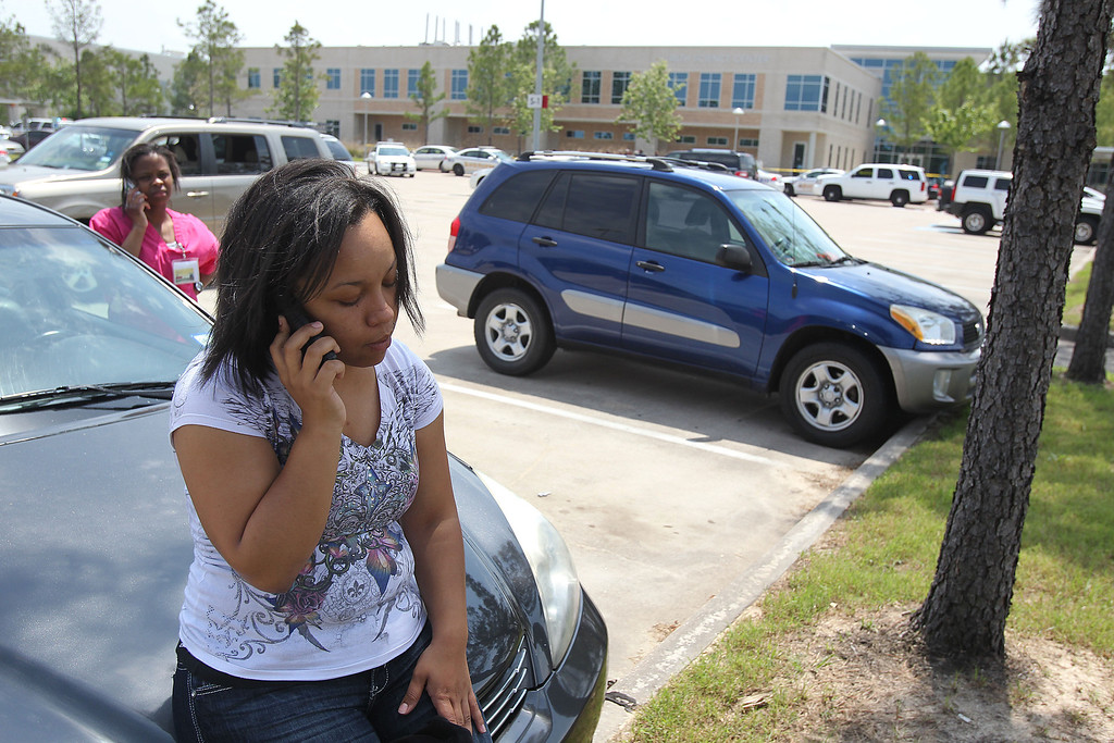 Description of . Nursing student Jessica Moffett, who rendered aid to injured students, talks on the phone at Lone Star College's Cy-Fair campus in Cypress, Texas, where a student went on a building-to-building stabbing attack Tuesday, April 9, 2013.
