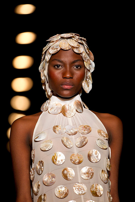Description of . A Model wears a creation by Gideon Oberson during a show at the Tel Aviv fashion week in Tel Aviv, Israel, Monday, Dec. 17, 2012. (AP Photo/Ariel Schalit)