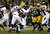Running back Adrian Peterson #28 of the Minnesota Vikings runs the ball in the first quarter against the Green Bay Packers during the NFC Wild Card Playoff game at Lambeau Field on January 5, 2013 in Green Bay, Wisconsin.  (Photo by Jonathan Daniel/Getty Images)