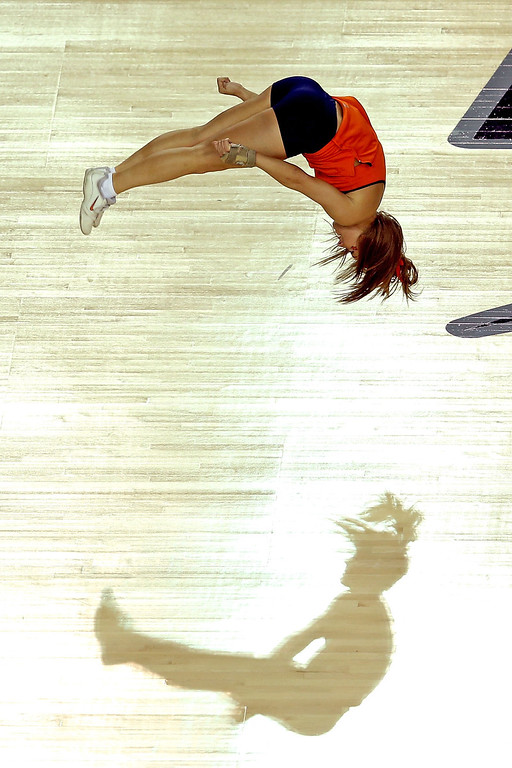 Description of . ATLANTA, GA - APRIL 06:  A cheerleader for the Syracuse Orange performs against the Michigan Wolverines during the 2013 NCAA Men's Final Four Semifinal at the Georgia Dome on April 6, 2013 in Atlanta, Georgia.  (Photo by Andy Lyons/Getty Images)