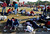 Supporters of Venezuela's late President Hugo Chavez lie on the ground as they wait for a chance to view his body lying in state, at the military academy in Caracas March 8, 2013.    REUTERS/Tomas Bravo