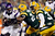 Running back Adrian Peterson #28 of the Minnesota Vikings runs the ball as he is hit by strong safety Charles Woodson #21 of the Green Bay Packers in the first quarter during the NFC Wild Card Playoff game at Lambeau Field on January 5, 2013 in Green Bay, Wisconsin.  (Photo by Andy Lyons/Getty Images)
