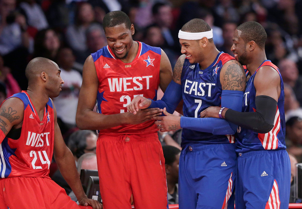 Description of . From left, West Team's Kobe Bryant, Kevin Durant, East Team's Carmelo Anthony and Dwyane Wade laugh during the first half of the NBA All-Star basketball game Sunday, Feb. 17, 2013, in Houston. (AP Photo/Eric Gay)