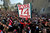 An Egyptian soccer fan of Al-Ahly club raises a banner honoring fellow fans killed in a 2012 stadium riot in the club headquarters in Cairo, Egypt, Saturday, March 9, 2013. (AP Photo/Amr Nabil)