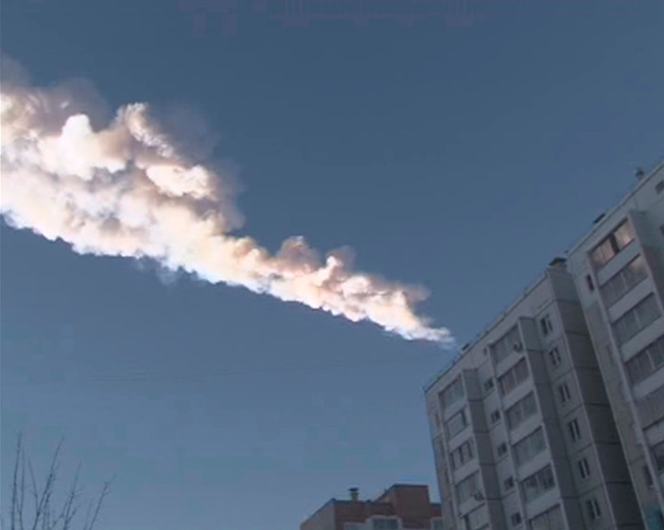 Description of . The trail of a falling object is seen above a residential apartment block in the Urals city of Chelyabinsk, in this still image taken from video shot on February 15, 2013. A powerful blast rocked the Russian region of the Urals early on Friday with bright objects, identified as possible meteorites, falling from the sky, emergency officials said. REUTERS/OOO Spetszakaz