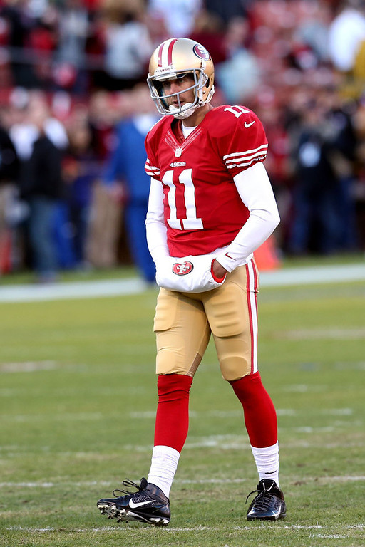 Description of . Quarterback Alex Smith #11 of the San Francisco 49ers looks on during warm ups prior to the NFC Divisional Playoff Game against the Green Bay Packers at Candlestick Park on January 12, 2013 in San Francisco, California.  (Photo by Stephen Dunn/Getty Images)