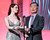 Presenters Ashley Clements (L) and George Takei speak onstage at the 3rd Annual Streamy Awards at Hollywood Palladium on February 17, 2013 in Hollywood, California.  (Photo by Frederick M. Brown/Getty Images)