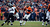 Denver Broncos quarterback Peyton Manning (18) looks for a receiver during the first quarter.  The Denver Broncos vs Baltimore Ravens AFC Divisional playoff game at Sports Authority Field Saturday January 12, 2013. (Photo by Hyoung Chang,/The Denver Post)
