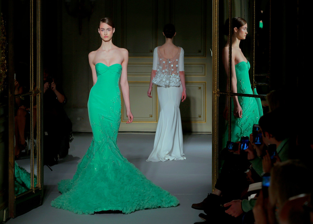 Description of . A model wears a creation by Lebanese fashion designer Georges Hobeika as part of the Women's Spring/Summer 2013 Haute Couture fashion collection presented in Paris, Monday , Jan. 21 2013 (AP Photo/ Jacques Brinon)