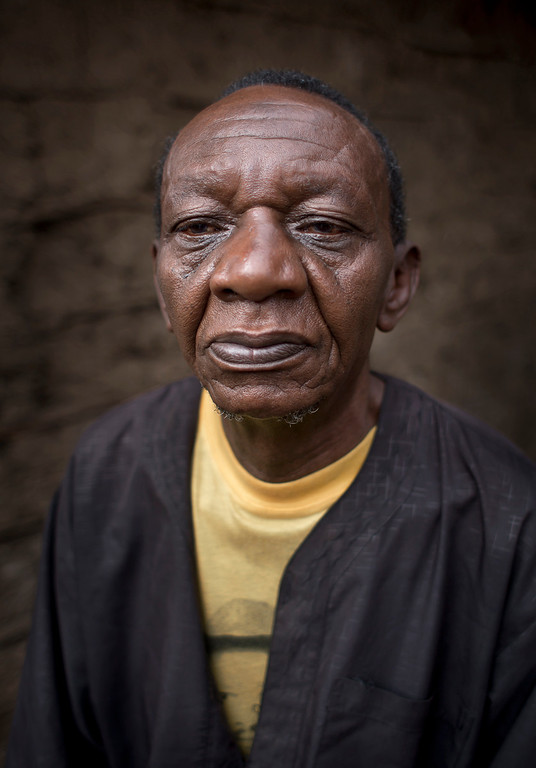 Description of . Juma Abdalla Athanas, 65, stands outside his home in the Kibera slum of Nairobi, Kenya on Friday, Sept. 6, 2013. When asked: As you grow older, what are you most afraid of and what is the biggest problem facing the elderly in your country? Abdalla Athanas said,