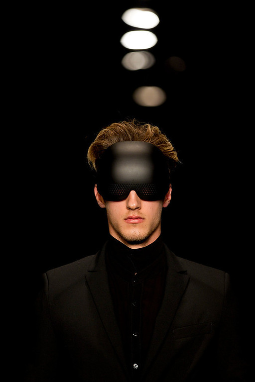 Description of . A model wears a creation by Israeli designer Yosef during a show at the Tel Aviv fashion week in Tel Aviv, Israel, Tuesday, Dec. 18, 2012. (AP Photo/Ariel Schalit)