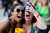 Rachel Everett, right, and her friend Bianca Lee try to catch a marshmellow in their mouths while during the 189-year-old St. Patrick's Day celebration on River Street, Friday, March 15, 2013, in Savannah, Ga. (AP Photo/Stephen Morton)