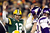 Quarterback Aaron Rodgers #12 of the Green Bay Packers signals for a touchdown on a run by teamamte running back DuJuan Harris #26 in the first quarter against the Minnesota Vikings during the NFC Wild Card Playoff game at Lambeau Field on January 5, 2013 in Green Bay, Wisconsin. Harris was awarded a touchdown after the play was reviewed.  (Photo by Andy Lyons/Getty Images)
