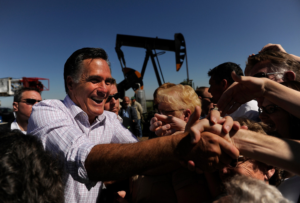 Description of . Governor Mitt Romney meets with supporters after talking about energy, Wednesday, May 09, 2012, during an event at K.P. Kauffman Company in Fort Lupton. RJ Sangosti, The Denver Post