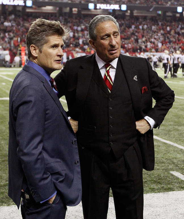 Description of . ATLANTA, GA - NOVEMBER 29:  Owner and CEO Arthur Blank and General Manager Thomas Dimitrof wait for an official review in the final minutes of the game between the Atlanta Falcons and the New Orleans Saints at Georgia Dome on November 29, 2012 in Atlanta, Georgia.  (Photo by Kevin C. Cox/Getty Images)