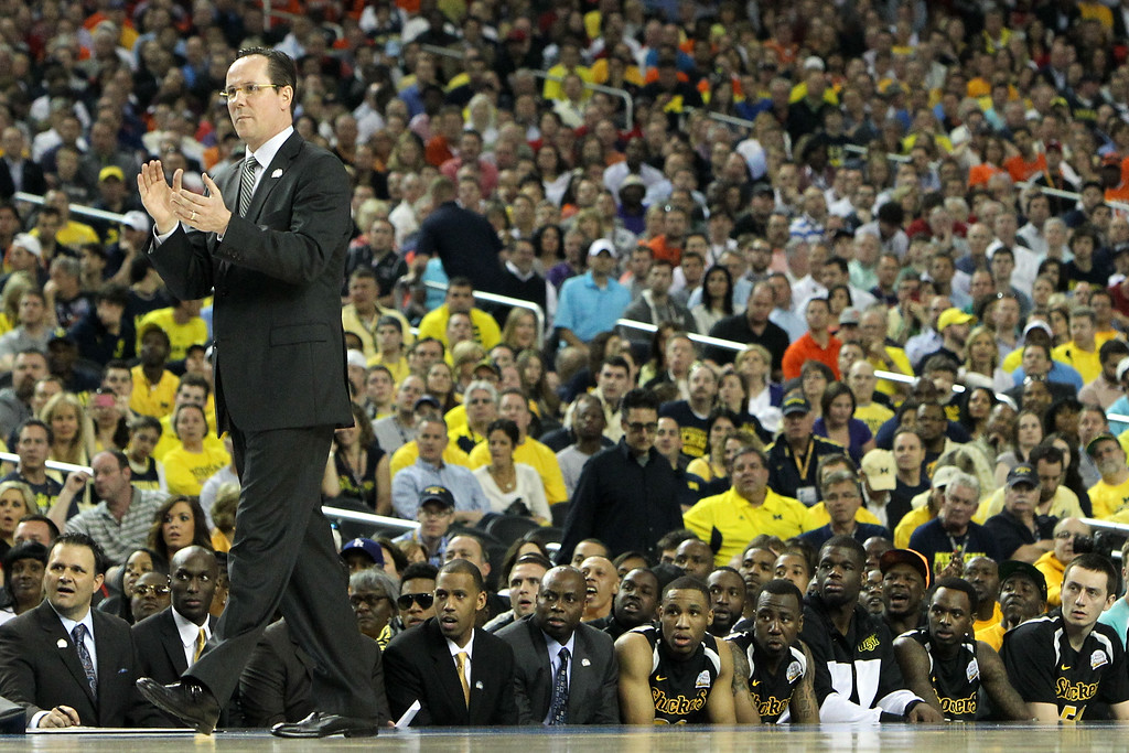Description of . ATLANTA, GA - APRIL 06:  Head coach Gregg Marshall of the Wichita State Shockers coaches as his players look on from the bench in the first half against the Louisville Cardinals during the 2013 NCAA Men's Final Four Semifinal at the Georgia Dome on April 6, 2013 in Atlanta, Georgia.  (Photo by Kevin C. Cox/Getty Images)