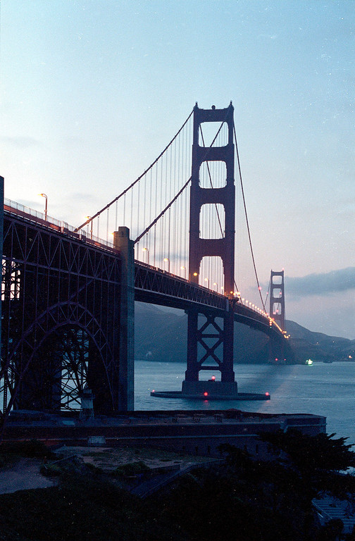 Description of . The Golden Gate Bridge, the famous structure that spans the San Francisco Bay, is seen at dusk on May 21, 1987. (AP Photo/Eric Risberg)