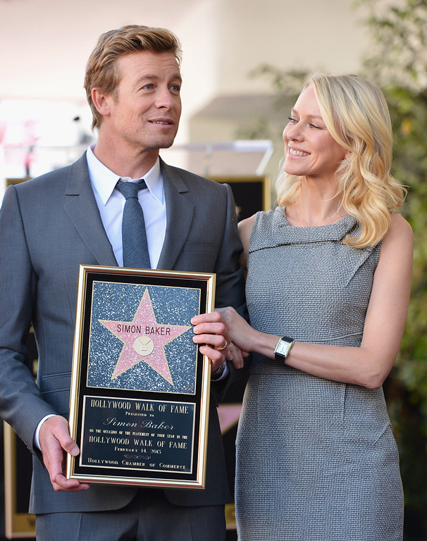 Description of . Actor Simon Baker and actress Naomi Watts attend a ceremony honoring Simon Baker with the 2,490th Star on The Hollywood Walk of Fame on February 14, 2013 in Hollywood, California.  (Photo by Alberto E. Rodriguez/Getty Images)
