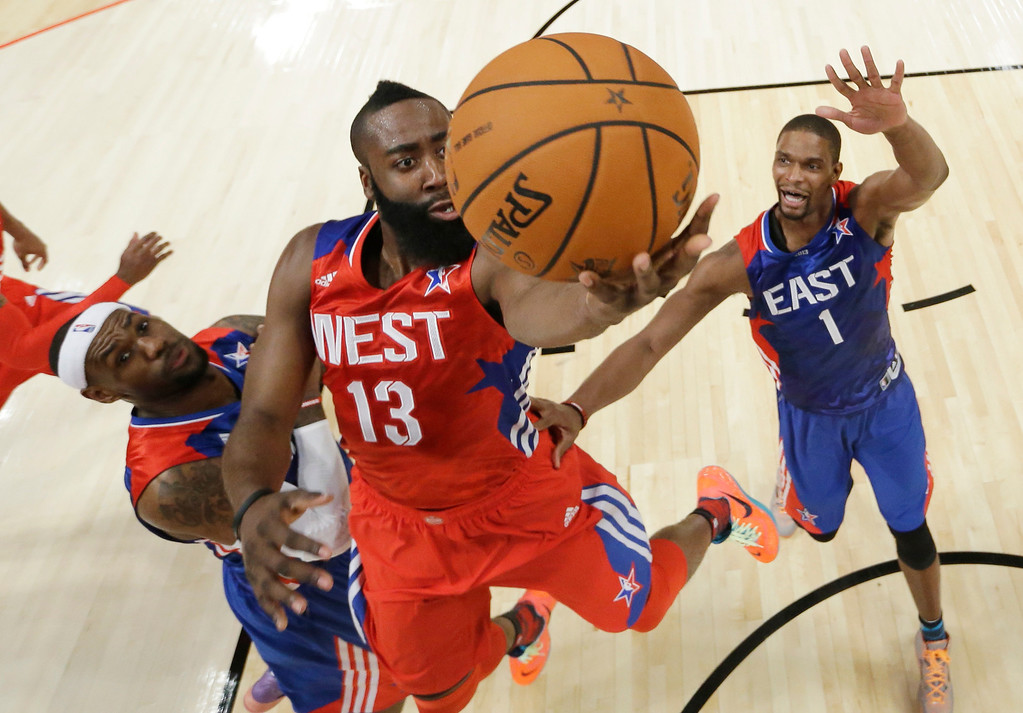 Description of . West Team's James Harden of the Houston Rockets shoots as East Team's LeBron James, left, and Chris Bosh of the Miami Heat defend during the second half of the NBA All-Star basketball game Sunday, Feb. 17, 2013, in Houston. (AP Photo/Eric Gay)