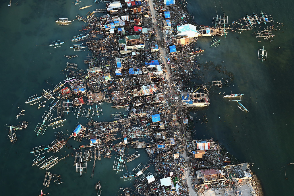 Description of . An aerial view of a demolished coastal town on Eastern Samar Island on November 14, 2013 in Leyte, Philippines. Typhoon Haiyan which ripped through Philippines over the weekend has been described as one of the most powerful typhoons ever to hit land, leaving thousands dead and hundreds of thousands homeless. Countries all over the world have pledged relief aid to help support those affected by the typhoon, however damage to the airport and roads have made moving the aid into the most affected areas very difficult. With dead bodies left out in the open air and very limited food, water and shelter, health concerns are growing.  (Photo by Dan Kitwood/Getty Images)