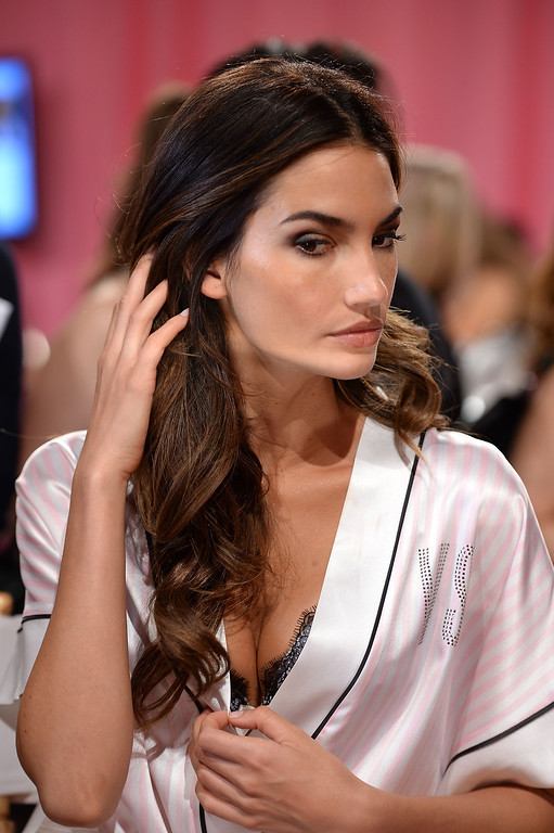 Description of . Model Lily Aldridge prepares at the 2013 Victoria's Secret Fashion Show hair and make-up room at Lexington Avenue Armory on November 13, 2013 in New York City.  (Photo by Dimitrios Kambouris/Getty Images for Victoria's Secret)